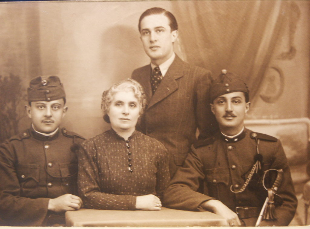 Grandmother Ella and sons 5/28/1940  Jenö, Sanyi, and Miki. Sanyi was not yet in the military as he had a deferment for his university studies. Jenö, who was disabled, and his mother were killed on arrival at Auschwitz, July 1, 1944.